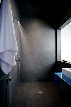 Dark walls #bathroom tiles, shower, vanity, mirror, faucets, sanitaryware, #interiordesign, mosaics,  modern, jacuzzi, bathtub, tempered glass, washbasins, shower panels #decorating