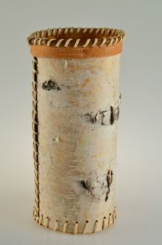 Tall Birch Bark Basket Artist Jenny Sanford... Dimensions: 12x5x5... $60...   Birch bark basket made to hold flowers or used as a container, trimmed with spruce root on the top and bottom.
