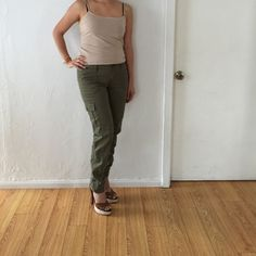 """Olive green skinny pants 4 Abercrombie & Fitch army green pants size 4. Skinny fit with side zipper at the bottom, I'm 5.5"""" tall for length reference and as you can see at the bottom they are long. small two dots on right front side, not too noticeable when wearing ( price reflects). BUNDLE & SAVE 25% ❌TRADES❌ Abercrombie & Fitch Pants Skinny"""