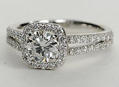 Brilliance defined, this diamond engagement ring features round diamonds set in a split shank and halo design of 14k white gold. $4,797, 0.66ct, Color D, Clarity vv2s, cut very good.