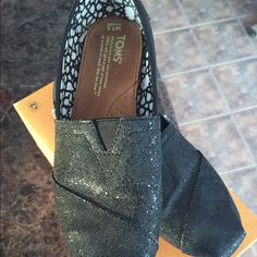 Tom's Sparkly Shoes Black Tom's shoes with sparkles!  Fabulous shoes, worn once! TOMS Shoes Flats & Loafers