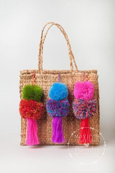 "Pom pom purse or suitcase charms. These fluffy 4-5"" Pom Poms are perfect for decorating purses, bags, doors... The entire charm is 15"" long. You will receive a similar product as the one showed in the picture, as colors and seizes may vary slightly as they are handmade. If you"