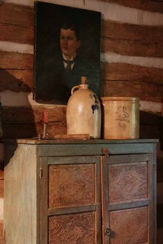 Love this collection: the primitive art, stoneware jug and pot and chest.