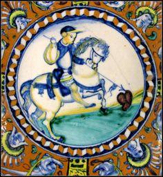 Chateau-Ecouen- Cavalier transperçant un coeur, marli à compartiments ornés de mascarons et de dauphins, Sienne, vers 1500-1510