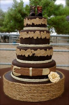 Western wedding cake! Not sure about the dark brown but love the belt buckle on bottom