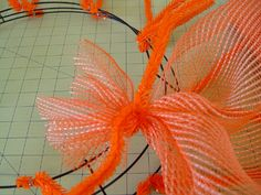 Halloween Wreath made with Vertical Line Deco Poly Mesh, Paper Mesh, ribbons and pumpkins ...more images and instructions on the Trendy Tree Blog http://www.trendytree.com/blog/halloween-wreath-tutorial-using-orange-vertical-line-mesh-and-black-white-paper-check/