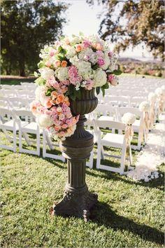 aisle wedding decor floral arrangement #aisledecor #outdoorwedding #weddingchicks http://www.weddingchicks.com/2014/02/07/pink-and-black-wedding/