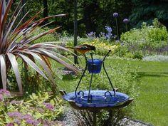 beautiful bird baths | Plate and candle holder makes beautiful bird bath | Outdoor Decor