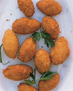 Croquettes are adorned with parsley for these bite-size appetizers.