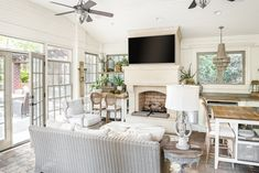 Gorgeous Sunroom in Waxhaw, NC by Award-Winning Interior Designer Sara Lynn Brennan This outdoor living room is made for relaxation and entertaining with its stone fireplace, paver floors, vaulted ceiling, and super comfortable woven rattan furniture. Fireplace Brick, Fireplace Furniture, Rattan Furniture, Transitional Fireplaces, Transitional Living Rooms, Transitional Decor, Home Interior Design, Interior Decorating, Sunroom Ideas
