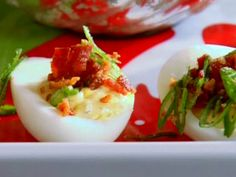 Holiday Horseradish Deviled Eggs recipe from Aaron McCargo Jr....I had these on Easter weekend with a slice of jalepeno pepper hidden in the bottom of the egg. To Die For Good. I'm renaming them Hog Camp Deviled Eggs. Thanks Amy.