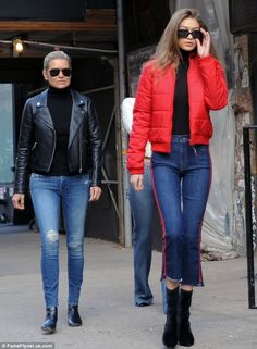 Red alert: Vogue model Gigi stood out in a bright jacket with cut jeans and boots