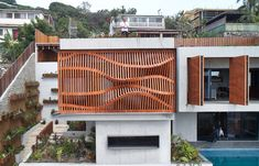 Completed in 2017 in Port Moresby, Papua New Guinea. Images by Peter Bennetts. The Brise Soleil House is a compact dwelling situated at the top of a steep, west-facing block near Port Moresby Harbour. Concrete Facade, Concrete Building, Concrete Wood, Wood Architecture, Residential Architecture, Timber Screens, House On Stilts, Workshop Design, Home Studio
