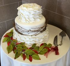 - Inspired by a picture the bride sent. 3 tier wedding cake covered by leaves and twigs