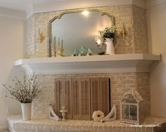 White washed brick fireplace with white wood mantle :) by brittany