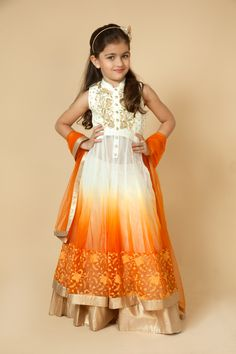 Dupion silk kurta with net lehenga embellished with sequins and resham work. Item number KG15-28