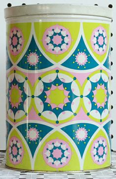 Dutch tins at online vintage store winter's moon. Via Print & Pattern