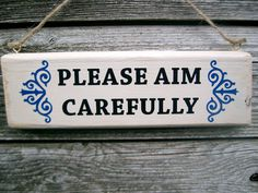 Funny toilet sign 'Please Aim Carefully'. by FairleyUniqueDecals