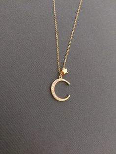 Dainty Vermeil star and CZ Embedded Vermeil crescent Moon charm Necklace on gold-filled chain. **Check out all My other Moon and Star Jewelries** http://www.etsy.com/shop/Muse411/search?search_query=star&order=date_desc&view_type=gallery&page=1 *Star measures approx. 4mm *Moon Measures approx. 14mm x 17mm ---------------------------------------------------------------------- **UPGRADE SHIPPING OPTION** https://www.etsy.com&#...