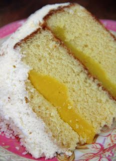 Layered Vanilla Butter Cake with Lemon Custard and Toasted Coconut