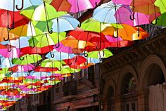 Photographer Patrícia Almeida captured this colorful umbrella installation along a sidewalk in Águeda, Portugal