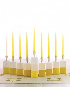 Wooden Block Menorah  Teach kids all about the traditions of Hanukkah, the Festival of Lights, with these easy menorah, dreidel, and gift-wrapping projects.  Kids will love helping build this modern menorah made with wooden blocks, cheery paint colors, and shiny candleholders.