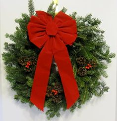 """Fresh Hand-made Decorated Fraser Fir Christmas Wreath - 24"""" Wide. Each wreath includes a weatherproof velvet bow, fresh pine cones and red berries. A tasteful holiday tradition, made fresh for your order."""