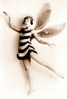"A JAPANESE FAIRY FROM FAIRY-LAND JAPAN    Ca.1920 by an unknown photographer. Probably a TAKARAZUKA GIRL, if she had been born only 30 years earlier, she might have become a talented Geisha. Of course, as flickr poster Muiz Anwar points out below, she is a BEE, and not a ""Fairy"""