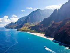On Kauai's northwest side lies the 17-mile Na Pali Coast, a jaw-dropping sight whether you are taking in its panoramic views from a helicopter, boat or on foot along the famed Kalalau Trail (a challenging 11-mile trek for experienced hikers only). With 3,000-foot towering cliffs plunging into white-sand beaches along the emerald Pacific Ocean, Na Pali Coast is definitely a must-see on Kauai.