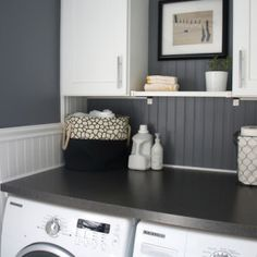 Home with Baxter did an incredible job renovating their half bath/laundry room. The top paint color is Benjamin Moore Rock Gray. This is the laundry room half of the room, so head over to see the bathroom side. It's amazing! Thanks, Jessica! See more gray paint colors... #benjaminmoorerockgray