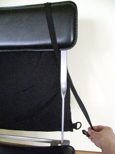 Built in security feature at restaurants and bars - unclip the strap and loop it  through your chair. http://trafficconebag.blogspot.com/2009/07/traffic-cone-bag-tm-hour-security.html