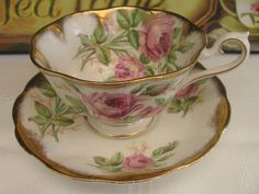 ROYAL ALBERT AVON SHAPED ROSES TREASURE CHEST TEA CUP & SAUCER SET DRIPPING GOLD