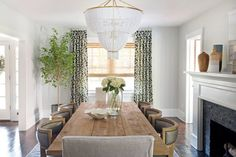 Haddonfield Project | Clean Transitional Dining room | Fresh, young and casual style | Long rectangular wooden dining room table | Linen slip covered dinging room chair | wood and leather dining room chair | White and Gold beaded chandelier in dining room | white and blue traditional rug | fireplace in dining room | dark walnut hardwood floors