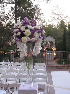 white orchid and purple reception wedding flowers,  wedding decor, wedding flower centerpiece, wedding flower arrangement, add pic source on comment and we will update it. www.myfloweraffair.com can create this beautiful wedding flower look.