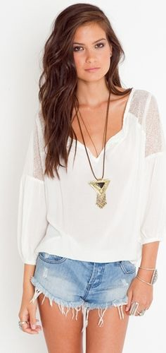 Love the necklace with a simple shirt
