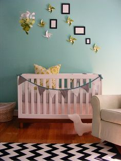 chevron rug, banner on bed and sweet pinwheels. Would love this in a different color scheme.