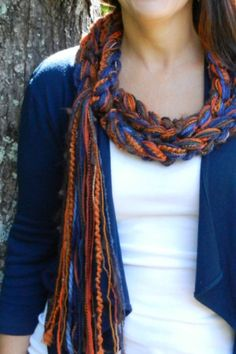 A Crochet scarf in Pumpkin, Navy and Brown. Pippy scarves can be worn a myriad of ways. Create a warm and toasty cowl around your neck or tie it loosely to display as 'jewelry' for your blouse.  PUMPKIN Jeans Pippy Scarf by sewstacy, $20.00