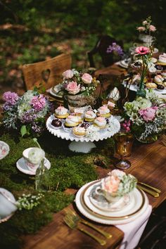 Sweets as centerpieces for this gorgeous woodland themed table