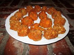 Sweet potatoes are combined with shredded coconut and spices in these delicious balls. Recipe by Jarafel.