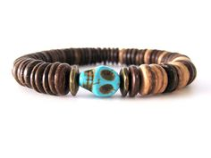 Very cool and hip turquoise magnesite skull bracelet for men. This handmade bracelet features coconut shell beads, turquoise magnesite skull focal bead and antiqued brass accent beads. A very trendy bracelet guys will love. Wear as shown or stacked with other bracelets and your favorite watch for a stylish option.