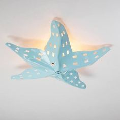 fish ceiling light - Google Search  $175 Starfish Ceiling Light Spa Blue  from Shades of Light  Hand cut tin forms this unique starfish ceiling light. Ours exclusively, it comes in the basic burnished tin (bronze) or the sea like color of spa blue. 2x60 watts. Beach Cottage Style, Beach Cottage Decor, Coastal Cottage, Coastal Style, Coastal Decor, Coastal Living, Beach Apartment Decor, Beach Condo Decor, Country Chic Cottage