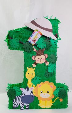 Number One Cute Safari Themed Pinata Safari Birthday Cakes, Boys 1st Birthday Party Ideas, Jungle Theme Birthday, Safari Theme Party, Wild One Birthday Party, Animal Birthday, 1st Boy Birthday, Jungle Theme Cakes, Hawaiian Party Decorations