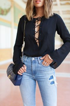 Alexa Chung for AG The Sabine Jeans: http://rstyle.me/n/9dfk4bxkwf (plain version here:http://bit.ly/1MjfhGz and similar here:http://bit.ly/1Q9jbQd), Similar lace up blouse (here:http://rstyle.me/n/9dg2qbxkwf and here:http://rstyle.me/n/9dg4fbxkwf), Chanel Vintage bag (affordable version here:http://bit.ly/1UOuYEW)