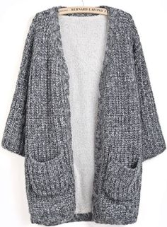 This is a grey, soft, yarn, V- neck, and short sleeves cardigan. The cardigan has a two pockets, . The size are medium, large and small, the price is $490.00.