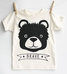Which type of bear is best? The brave bear of course. PRODUCT DETAILS natural: 100% Organic Cotton ring-spun jersey bodysuit Printed with eco-friendly water based ink Professionally heat set to remain color fast. TO NOTE As t-shirt is printed by hand, please allow for very slight variations. CARE Wash cold, line dry recommended. Shirt will shrink up to a half size. DELIVERY DETAILS As each item is hand printed to order, please be sure to check our current production schedule prior to…