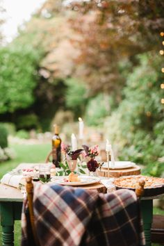 Rustic fall tablescape with a plaid throw blanket