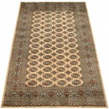 Beautiful soft pile wool oriental rug. This beige area rug has a geometric pattern with a beautiful sheen and will be a wonderful addition to your home decor',or a beautiful starting point for decorating the rooms in your new home. This handmade oriental rug is made to last a good long while and bring warmth to any room in your home.