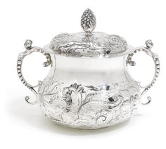 A Charles II silver porringer and cover, maker's mark FS a flower, London, 1670 the circular baluster body and cover each embossed with a lion and dragon passant, bud finial, underside stippled F*C*S