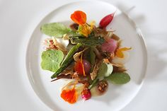 Garden radishes, pigs ear and nasturtium honey, is part of the menu at the newly remodeled Saison