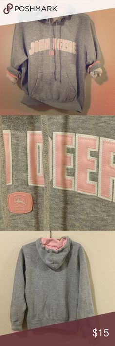 John Deer Hoodie Gray and pink john deer pullover Hoodie. Logo patch across chest with stitched on lettering. Pink lined hood and pink trim on sleeve cuffs. Full front pocket. John Deere Tops Sweatshirts & Hoodies